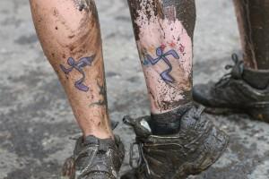 Runningman logo tattoo